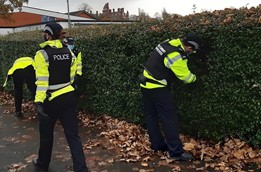 Lancashire Police officers conducting a weapon sweep.